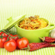 Delicious pilaf with vegetables on tablecloth background - Stock Photo