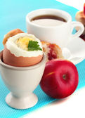 Light breakfast with boiled egg and cup of coffee, close up — Stock Photo
