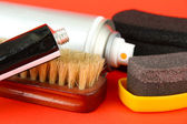 Set of stuff for cleaning and polish shoes, on color background — Stock Photo