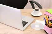 Cup of coffee on office desktop close-up — Stock Photo