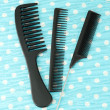 Black combs on color background — Stock Photo #21541683