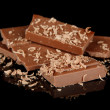 Milk chocolate isolated on black - Stock Photo
