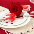 Table setting in honor of Valentine's Day close-up — Stock Photo #21542065