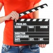 Movie production clapper board in hands isolated on white — Foto Stock