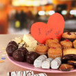 Sweet cookies with valentine card on plate on table in cafe - Stockfoto