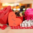 Sweet cookies in gift box on table in cafe — Stock Photo #21542401