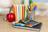 School supplies on wooden table — Stock Photo