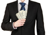 Business man hiding money in pocket isolated on white — Stock Photo