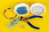Set for needlework on yellow background — Stock Photo