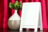 White photo frame for home decoration on curtains background — Stockfoto