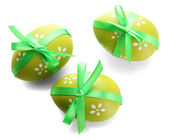 Bright easter eggs with bows, isolated on white — Stock Photo