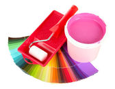 Set for painting: paint pot, paint-roller and palette of colors isolated on white — Stock Photo