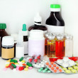 Stock Photo: Medical bottles and pills on shelf