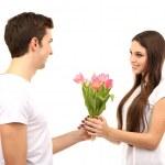 Loving couple with tulips isolated on white — Stock Photo #21645255