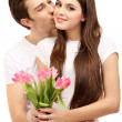Loving couple with tulips isolated on white — Stock Photo #21645257