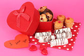 Sweet cookies in gift box on pink background — Foto Stock