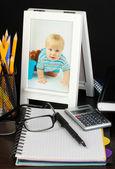 White photo frame on office desk on grey background — Stock Photo