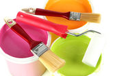 Set for painting: paint pots, brushes, paint-roller close up — Stock Photo