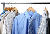 Shirts with ties on wooden hangers isolated on white — Stok fotoğraf