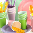 Multicolored plastic tableware close up — Stock Photo