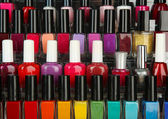 Bright nail polishes on shelf, close up — Stock Photo
