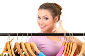 Young girl buying clothes isolated on white — Stock Photo