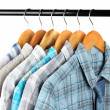 Shirts with ties on wooden hangers on light background — Foto Stock