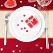Table setting in honor of Valentine's Day close-up — Stock Photo #21769233