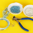 Stock Photo: Set for needlework on yellow background