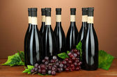 Wine bottles on brown background — Stok fotoğraf