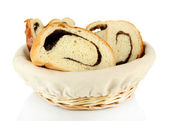 Loaf with poppy seeds in wicker basket, isolated on whit — Stock Photo