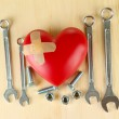 Heart and tools. Concept: Renovation of heart. On wooden background — Stock Photo #21771365