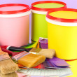 Set for painting: paint pots, brushes, palette of colors on lilac background - Stock Photo