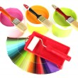 Set for painting: paint pots, brushes, paint-roller and palette of colors isolated on white - Stock Photo