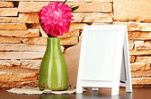 White photo frame for home decoration on stone wall background — Stock Photo