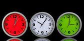 Round office clocks on black background — Stock Photo