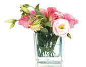 Bouquet of eustoma flowers in vase isolated on white — Stok fotoğraf