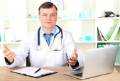 Medical doctor working at desk — Stock Photo