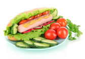 Tasty hot dog with vegetables isolated on white — Stock Photo