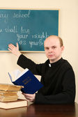 Priest in Sunday school — Stock Photo