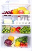 Refrigerator full of food — Stock Photo
