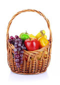 Different fruits in wicker basket isolated on white — Stock Photo