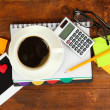 Cup of coffee on worktable close up — Stock Photo