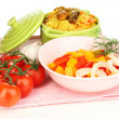 Delicious pilaf with vegetables isolated on white - Stock Photo
