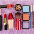 Decorative cosmetics on purple background — Stock Photo #21912587