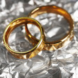 Wedding rings on silver background - Stok fotoraf