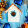 Nesting box and Christmas decorations on blue background - Stock fotografie