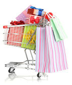 Christmas gifts and shopping in trolley isolated on white — Stok fotoğraf