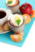 Light breakfast with boiled eggs and cup of coffee, isolated on white — Stock Photo