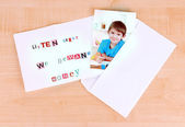 Letter to requirements of kidnapper on wooden table close-up — Stock Photo